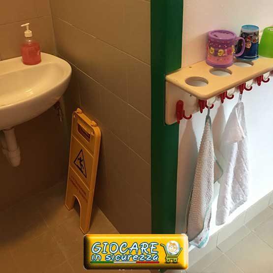 Angolare incollato su muro di un bagno scolastico