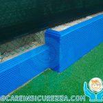 Protezioni in gomma per esterni su muretto campo sportivo