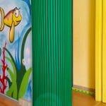 Verde protezione aderente in gomma antitrauma per spazio giochi bambini